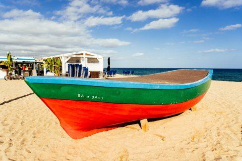 Old fishing boats on the beach of Badalona, near Barcelona, Spain